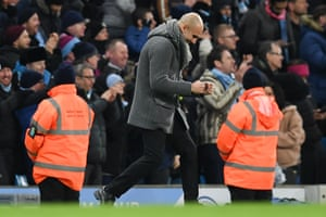 Manchester City's manager Pep Guardiola reacts on the touchline after the third goal