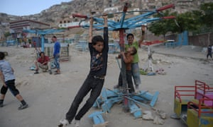 Boys play on a swing in Kabul, June 2016