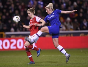 Millie Bright of Chelsea clears the ball away from Arsenal's Vivianne Miedema.