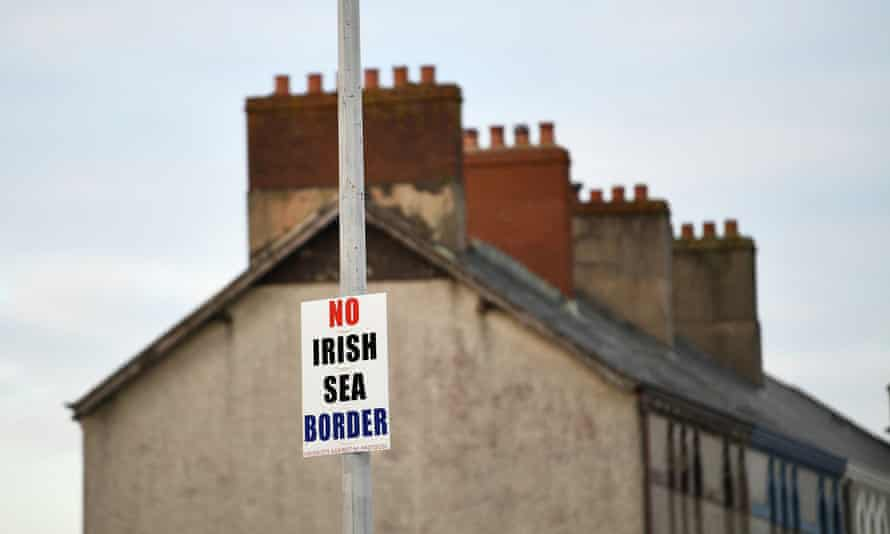 A sign affixed to a lamppost in the port of Larne, Northern Ireland. The EU launched infringement proceedings against the UK over Brexit last week.