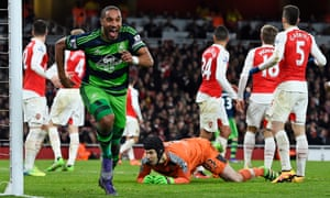 Swansea's Sigurdsson takes a free kick it but no Arsenal player tries to intercept it as Ashley Williams bundles it in near the far post for their winning second goal