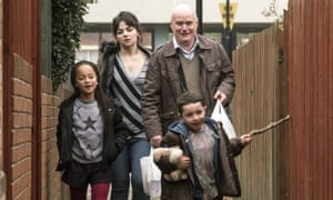 Briana Shann, Hayley Squires, Dave Johns and Dylan McKiernan in a scene from I, Daniel Blake