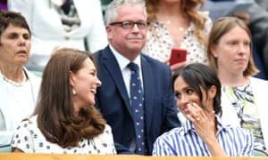 Kate, The Duchess of Cambridge, and Meghan, The Duchess of Sussex, chat in the Centre Court Royal Box.
