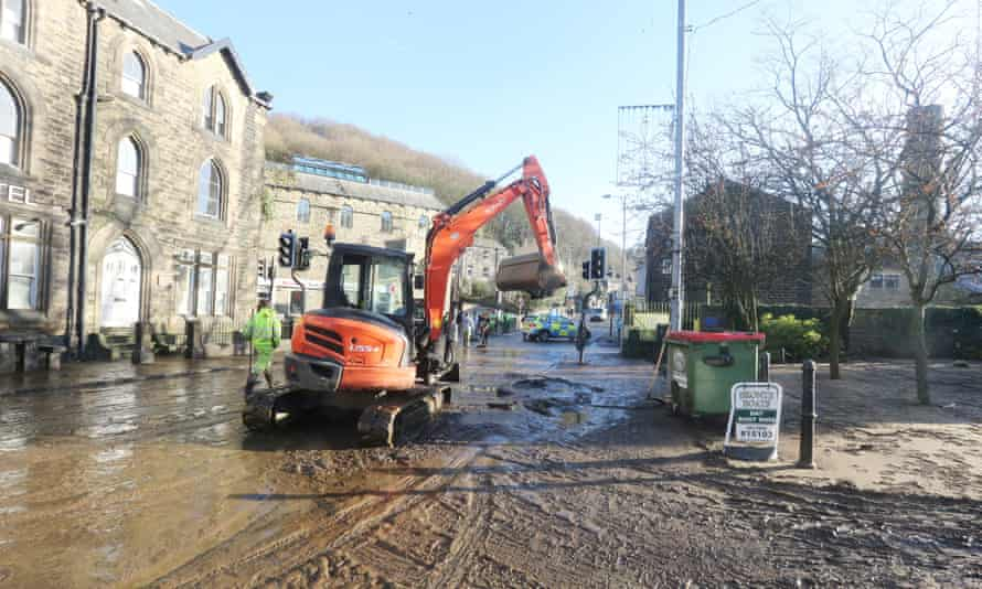 The clean up process begins in Hebden Bridge, West Yorkshire.