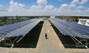 Solar panels are installed on a carport at Garden City shopping centre in Nairobi, Kenya.