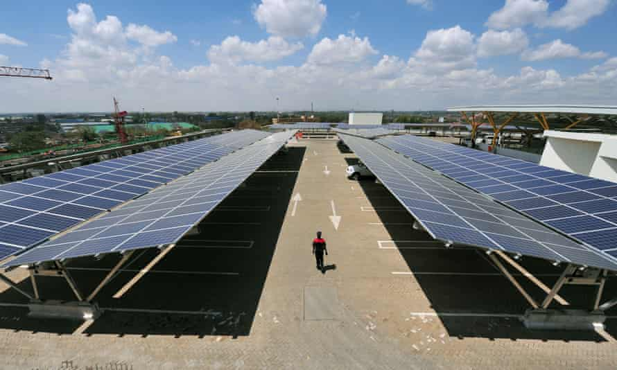 Solar panels are installed on a carport at Garden City shopping centre in Nairobi, Kenya.