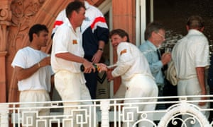 Robin Smith is caught in the bubbly stream as Angus Fraser celebrates England's win over West Indies in the second Test at Lord's in June 1995.