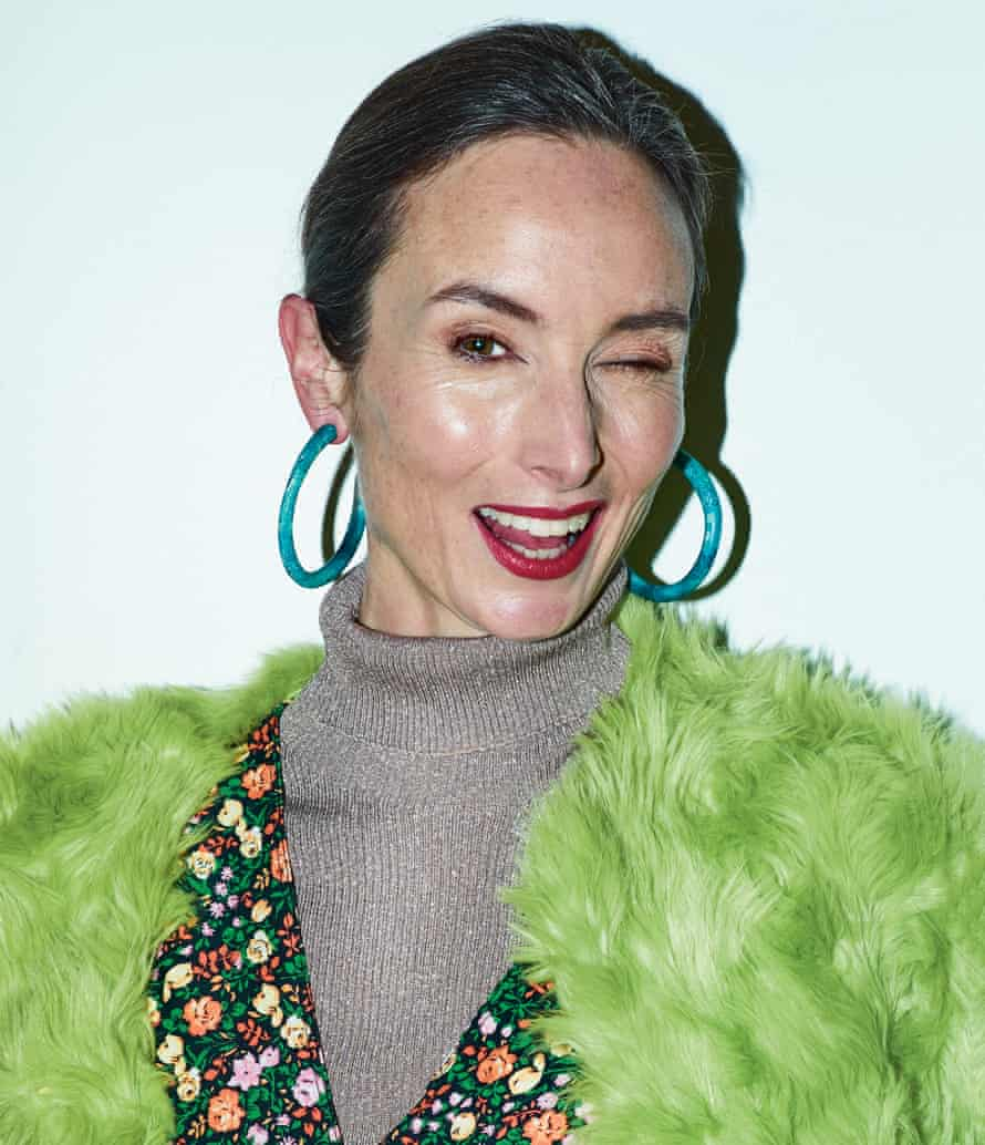 Green goddess: Karen wears coat by Shrimps, dress by Ganni, roll neck by 3.1 Phillip Lim, and earrings by Dinosaur Designs