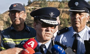 Cyprus police chief, Kypros Michaelides, speaks during the search for bodies of victims.