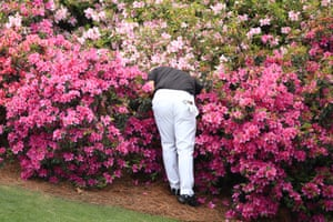 Augusta, Georgia, US. Patrick Reed of the US searches for his ball on the 13th hole during the first round of the Masters at Augusta National Golf Club