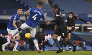 Manchester City's Bernardo Silva, right, scores his side's third goal.