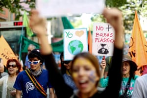 Protesters in Santiago, Chile. The banner reads 'No more plastic bags'
