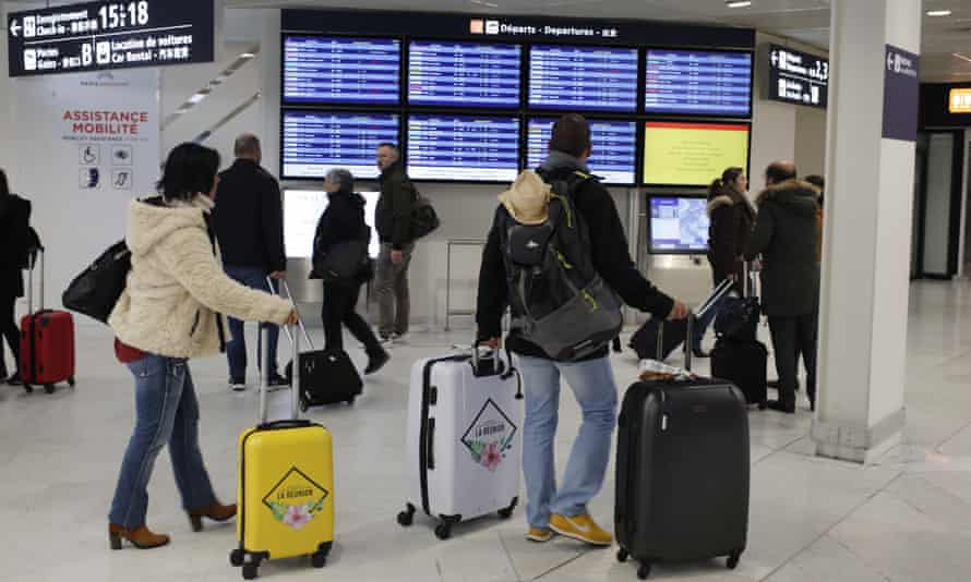 Passengers check flight information at Orly airport, Paris