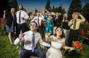 Bride and groom in eclipse glasses