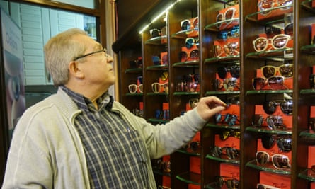 Mohammed Dahabi selects a pair of sunglasses for a potential customer.