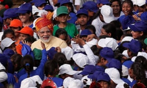 Modi greets schoolchildren after addressing the nation from the Red Fort.