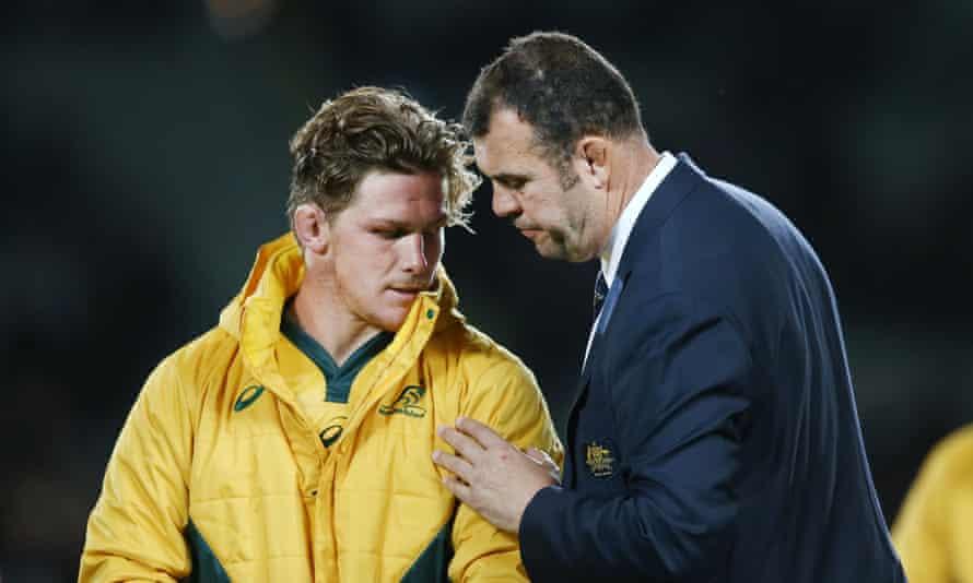 Michael Cheika consoles Wallabies captain Michael Hooper