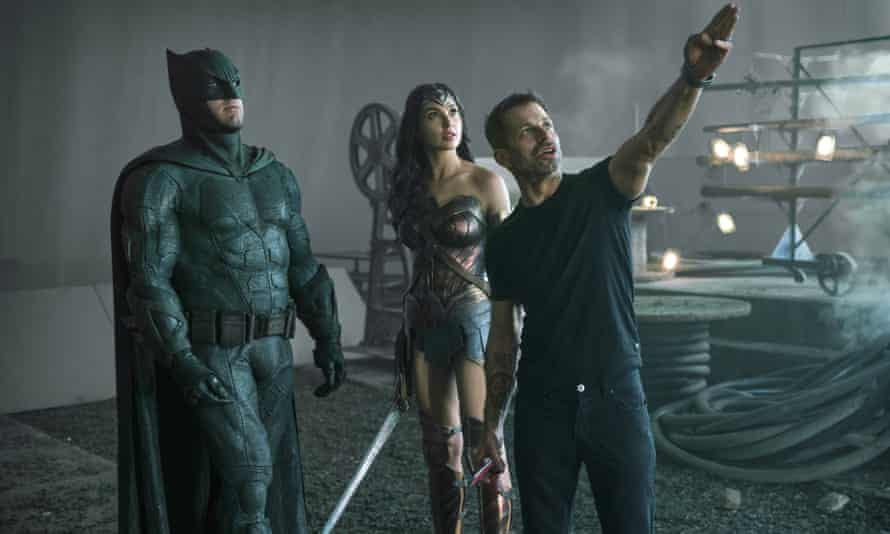 Snyder, right, with Ben Affleck as Batman (left) and Gal Gadot as Wonder Woman on the set of Zack Snyder's Justice League.