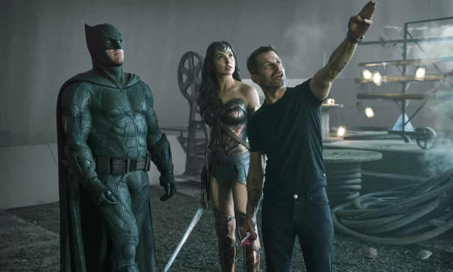 Snyder on the set of Justice League, with Ben Affleck as Batman and Gal Gadot as Wonder Woman.