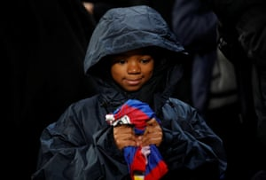 A young Crystal Palace fan holds Andros Townsend's shirt after the match.