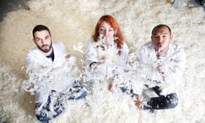 The creators of FeatherFill covered in feathers