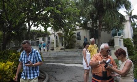 Tourists walk around the home that once belonged to Hemingway, known as Finca Vigía, in Havana.