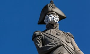 A face mask is placed on the statue of Nelson's Column by Greenpeace protesters in London. Londoners living in the city's most deprived areas were on average more exposed to poor air quality than those in more affluent areas.