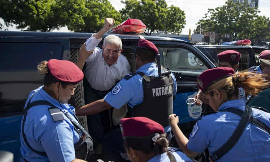 Police agents detain demonstrators participating in the 'United for the Freedom' march, in Managua.