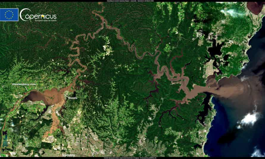 Satellite imagery shows flood water containing debris washing out from the Hawkesbury River to sea in New South Wales.