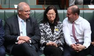 Scott Morrison, Gladys Liu and Josh Frydenberg sit together in parliament