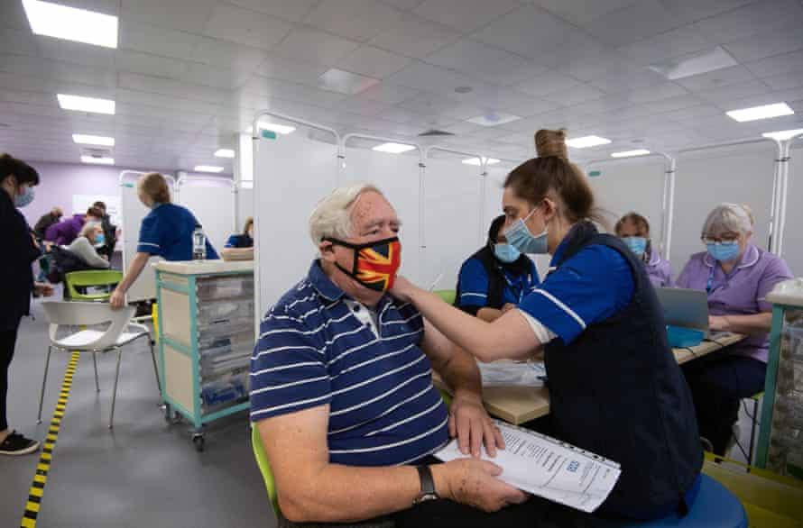 Immunisation at an NHS vaccine centre in  Hertfordshire