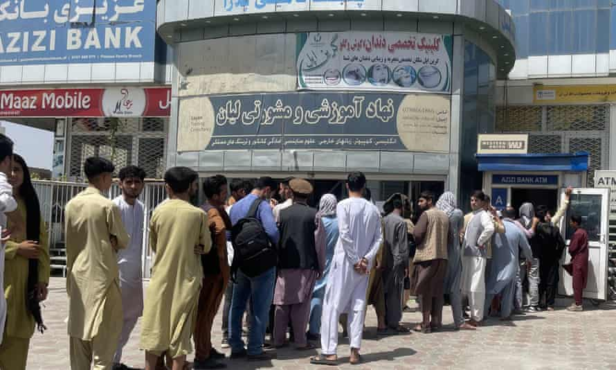 People queuing to withdraw money from a bank in Kabul on Sunday.