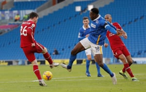 Andy Robertson kicks the foot of Brighton's Danny Welbeck.