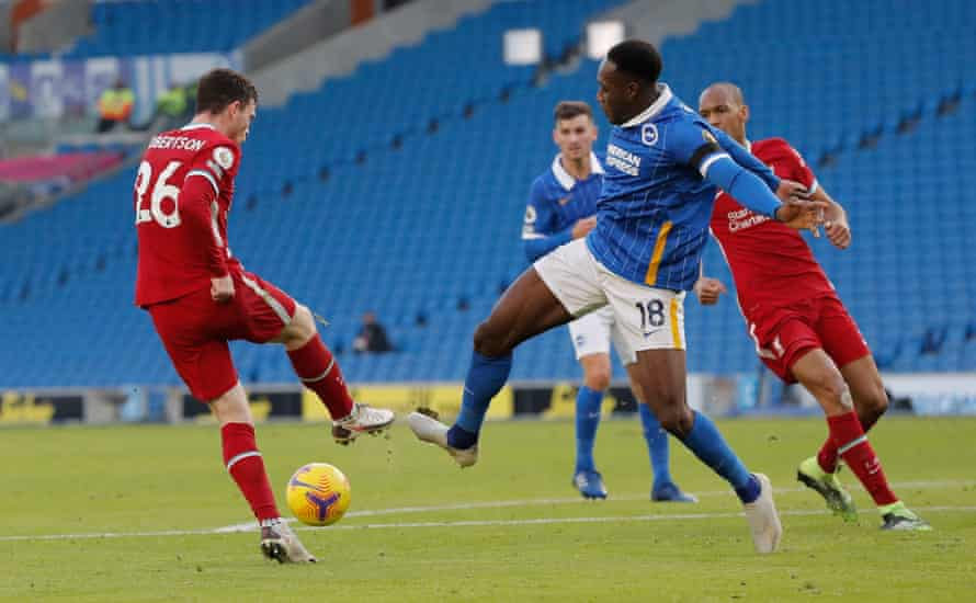 Andy Robertson makes contact with the foot of Brighton's Danny Welbeck. A penalty was awarded for Brighton after VAR intervention.