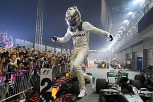 Hamilton celebrates winning the Singapore Grand Prix.
