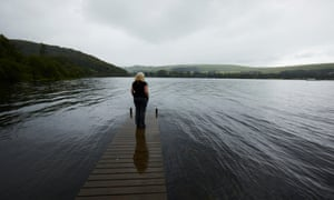 Gail Corbishley, the property manager of the Duke of Portland boathouse, looks out over Ullswater in Cumbria.