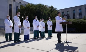 Doctors outside Walter Reed medical center on Saturday.