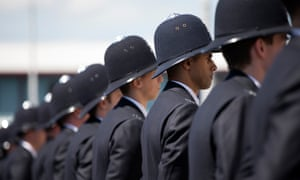 Police cadets who have completed their training take part in their 'Passing Out Parade'