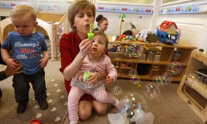 Nicola Sturgeon, pictured at a nursery in Loanhead during the 2015 election campaign, plans to double free childcare provision.
