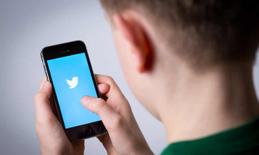 Teenage boy using Twitter