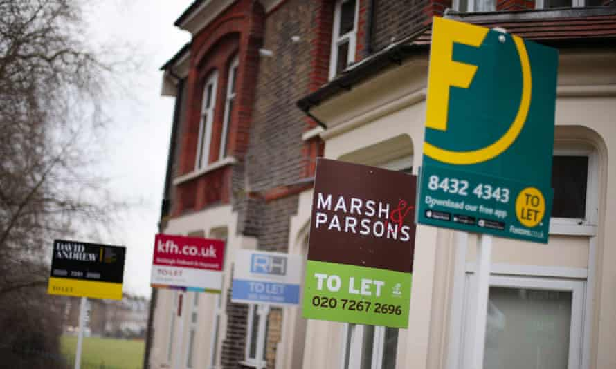 Signs advertising rental property outside houses in north London.