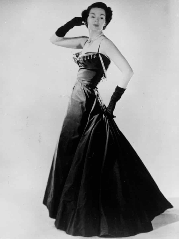 Barbara Goalen models an evening dress by Dior in 1947.