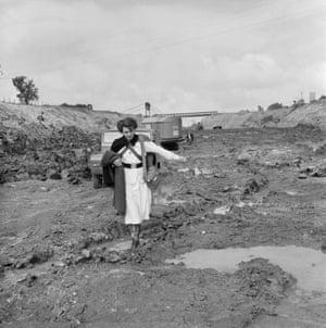 Nurse wading through mud