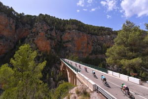 The riders cross a bridge on the seventh stage - the 207km ride from Llíria to Cuenca