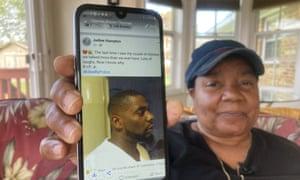 Glenda Brown Thomas displays a photo of her nephew, Andrew Brown Jr.