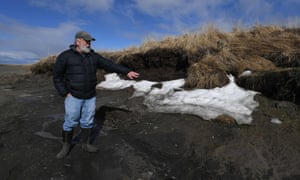 Rick Knecht, an archeologist, shows a site threatened by climate breakdown erosion caused by melting permafrost on the Yukon Delta in Alaska.