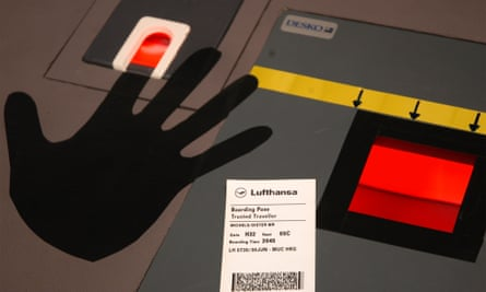 A biometric terminal with fingerprint scanner, left, and boarding card scanner, right