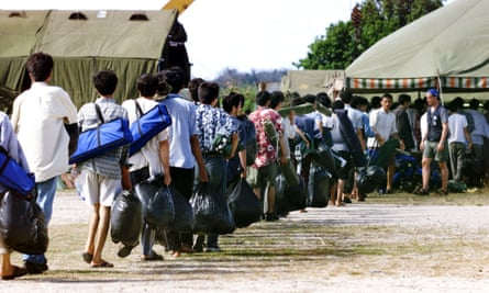 Asylum seekers from Afghanistan arriving at a camp on the island of Nauru after attempting to reach Australia, in September 2001.