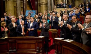 Carles Puigdemont and parliamentarians applaud at the end of the session at the plenary room of the Catalonian parliament after declaring independence.