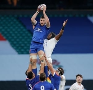 France's Charles Ollivon beats Maro Itoje of England to the ball during a lineout.